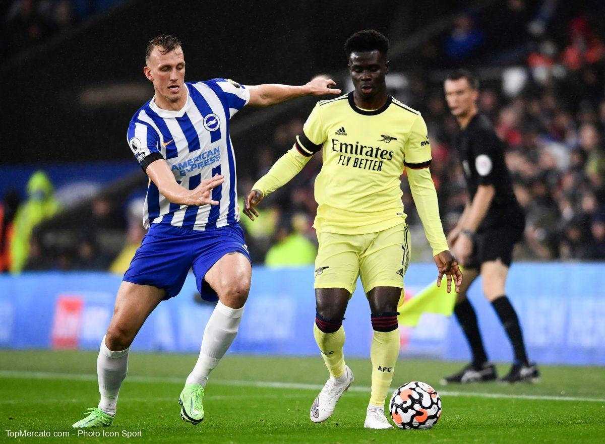 Dan Burn et Bukayo Saka, match Brighton and Hove Albion-Arsenal